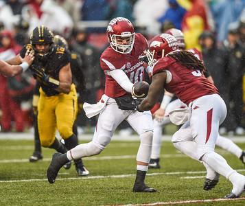 Arkansas Razorbacks quarterback Brandon Allen (10) hands off to Arkansas Razorbacks running back Alex Collins (3) during a football game between Arkansas and Missouri on November 27, 2015.    (Alan Jamison, Nate Allen Sports Service)