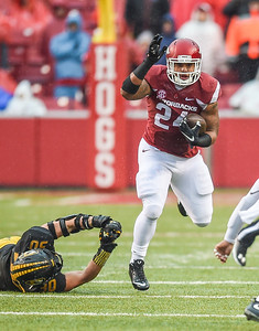 Arkansas Razorbacks running back Kody Walker (24) with a rush during a football game between Arkansas and Missouri on November 27, 2015.    (Alan Jamison, Nate Allen Sports Service)
