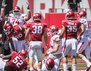Colton Jackson signals a touchdown rush by Denzell Evans during the Arkansas Razorback Spring Football Game on 4/23/2016.   (Alan Jamison, Nate Allen Sports Service)