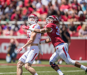 Cody Hollister looks for the ball as Byron Keaton defends during the Arkansas Razorback Spring Football Game on 4/23/2016.   (Alan Jamison, Nate Allen Sports Service)