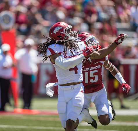 Keon Hatcher looks for the ball as Willie Sykes defends during the Arkansas Razorback Spring Football Game on 4/23/2016.   (Alan Jamison, Nate Allen Sports Service)