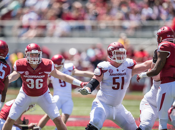 Jake Hall and Hjalte Froholdt defend on special teams during the Arkansas Razorback Spring Football Game on 4/23/2016.   (Alan Jamison, Nate Allen Sports Service)
