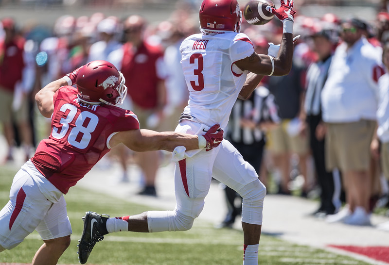 Dominique Reed catches a pass against Reid Miller during the Arkansas Razorback Spring Football Game on 4/23/2016.   (Alan Jamison, Nate Allen Sports Service)