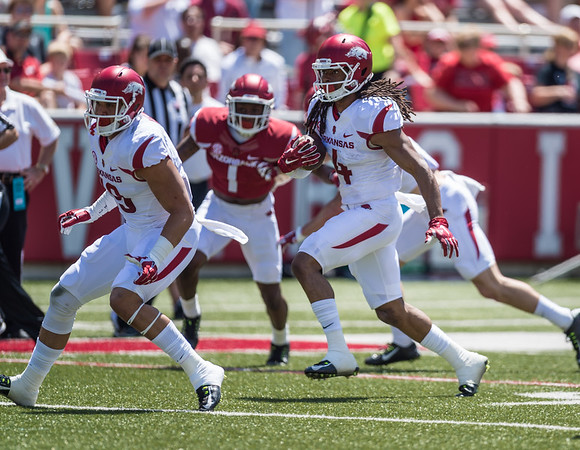 Keon Hatcher carries the ball during the Arkansas Razorback Spring Football Game on 4/23/2016.   (Alan Jamison, Nate Allen Sports Service)