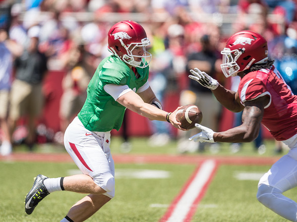 Rate Peavey hands off to Duwop Mitchell during the Arkansas Razorback Spring Football Game on 4/23/2016.   (Alan Jamison, Nate Allen Sports Service)