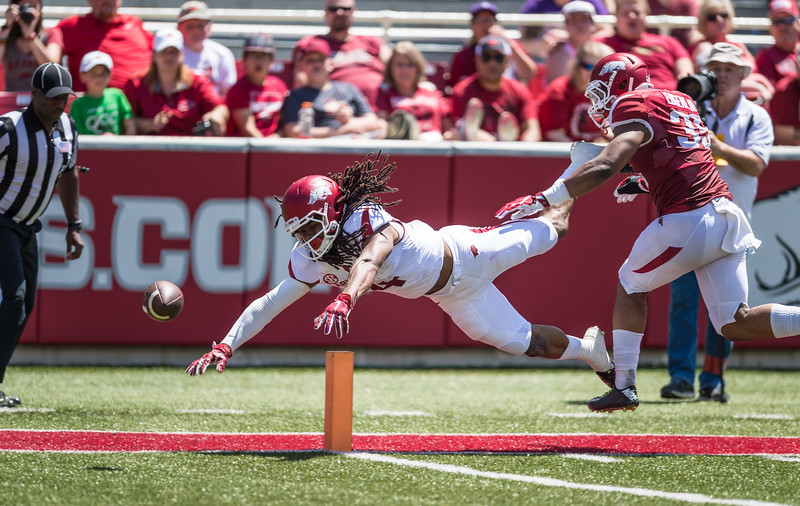 Keon Hatcher fumbles through the end zone for a touchback as Dwayne Eugene defends during the Arkansas Razorback Spring Football Game on 4/23/2016.   (Alan Jamison, Nate Allen Sports Service)