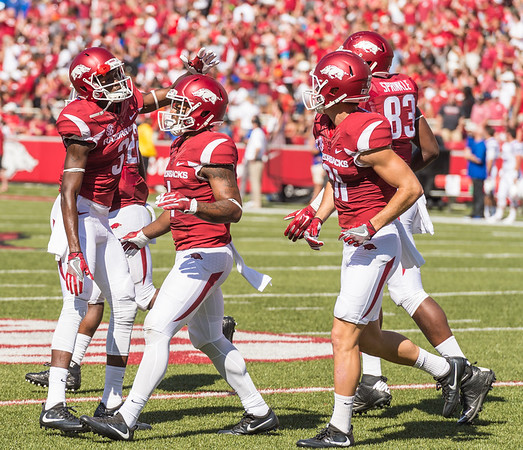 Arkansas Razorbacks wide receiver Dominique Reed (3) congratulates Jared Cornelius on his touchdown during a football game between the Arkansas Razorbacks and the Louisiana Tech Bulldogs on Saturday, September 3, 2016.  (Alan Jamison, Nate Allen Sports Service)