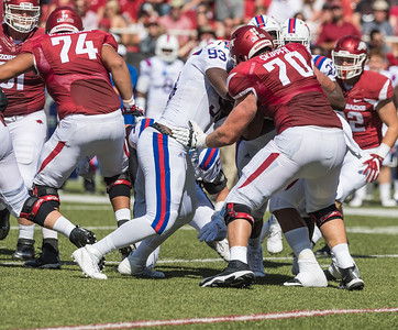 Arkansas Razorbacks offensive lineman Dan Skipper (70) blocks three defenders during a football game between the Arkansas Razorbacks and the Louisiana Tech Bulldogs on Saturday, September 3, 2016.  (Alan Jamison, Nate Allen Sports Service)