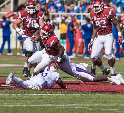 Arkansas Razorbacks running back Rawleigh Williams III (22) rushes during a football game between the Arkansas Razorbacks and the Louisiana Tech Bulldogs on Saturday, September 3, 2016.  (Alan Jamison, Nate Allen Sports Service)