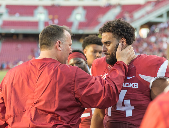 Arkansas head coach Bret Bielema congratulates Colton Jackson after the football game between the Arkansas Razorbacks and the Louisiana Tech Bulldogs on Saturday, September 3, 2016.  (Alan Jamison, Nate Allen Sports Service)
