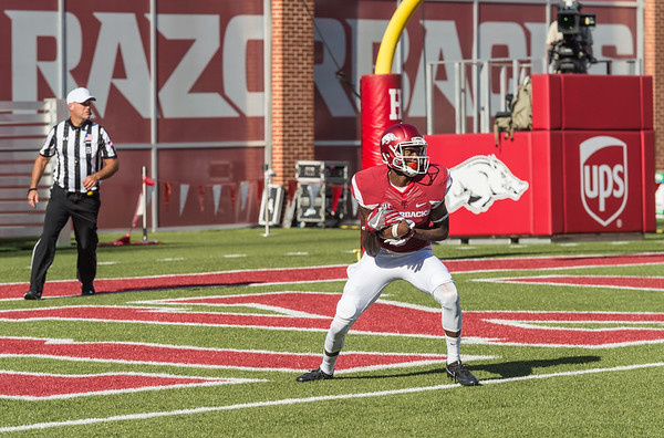 Arkansas Razorbacks wide receiver Dominique Reed (3) takes a kickoff in the end zone during a football game between the Arkansas Razorbacks and the Louisiana Tech Bulldogs on Saturday, September 3, 2016.  (Alan Jamison, Nate Allen Sports Service)