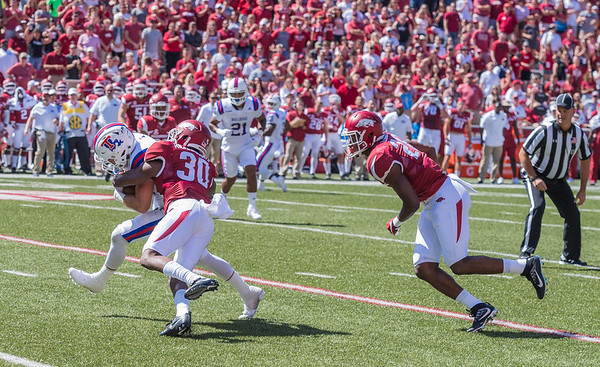 Arkansas Razorbacks defensive back Kevin Richardson II (30) with a tackle during a football game between the Arkansas Razorbacks and the Louisiana Tech Bulldogs on Saturday, September 3, 2016.  (Alan Jamison, Nate Allen Sports Service)