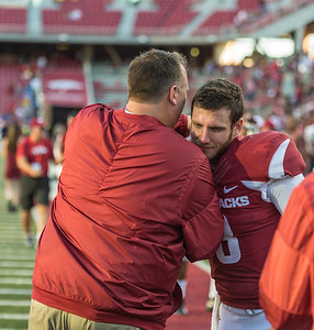 Arkansas head coach Bret Bielema congratulates Austin Allen after the football game between the Arkansas Razorbacks and the Louisiana Tech Bulldogs on Saturday, September 3, 2016.  (Alan Jamison, Nate Allen Sports Service)