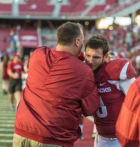 Arkansas head coach Bret Bielema congratulates Austin Allen after the football game between the Arkansas Razorbacks and the Louisiana Tech Bulldogs on Saturday, September 3, 2016.  (Alan Jamison, Nate Allen Sports Service)