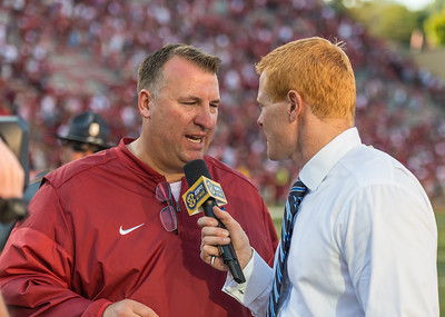 Arkansas head coach Bret Bielema being interviewed after the football game between the Arkansas Razorbacks and the Louisiana Tech Bulldogs on Saturday, September 3, 2016.  (Alan Jamison, Nate Allen Sports Service)