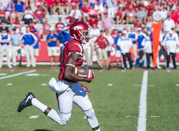 Arkansas Razorbacks wide receiver Dominique Reed (3) returns a kickoff during a football game between the Arkansas Razorbacks and the Louisiana Tech Bulldogs on Saturday, September 3, 2016.  (Alan Jamison, Nate Allen Sports Service)