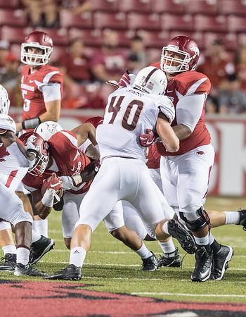 Arkansas Razorbacks offensive lineman Johnny Gibson (62) blocks Texas State Bobcats linebacker Stephen Smith (40) during a football game between the Arkansas Razorbacks and the Texas State Bobcats on Saturday, September 17, 2016.  (Alan Jamison, Nate Allen Sports Service)