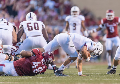 Arkansas Razorbacks defensive lineman Deatrich Wise Jr. (48) with a sack during a football game between the Arkansas Razorbacks and the Texas State Bobcats on Saturday, September 17, 2016.  (Alan Jamison, Nate Allen Sports Service)