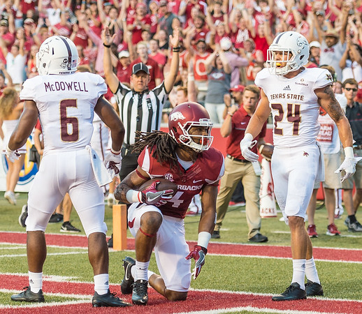 Arkansas Razorbacks wide receiver Keon Hatcher (4) in the end zone with a touchdown catch during a football game between the Arkansas Razorbacks and the Texas State Bobcats on Saturday, September 17, 2016.  (Alan Jamison, Nate Allen Sports Service)