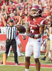 Arkansas Razorbacks wide receiver Keon Hatcher (4) gives the ball to an official after scoring a touchdown during a football game between the Arkansas Razorbacks and the Texas State Bobcats on Saturday, September 17, 2016.  (Alan Jamison, Nate Allen Sports Service)