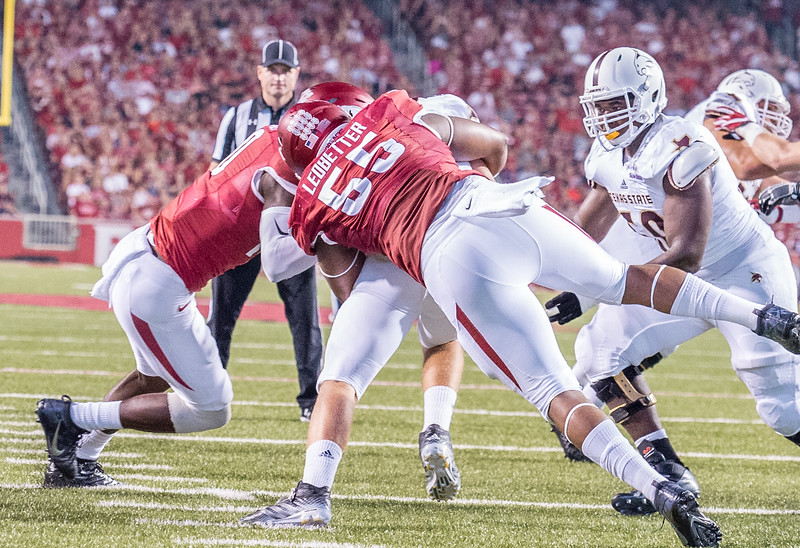 Arkansas Razorbacks defensive lineman Jeremiah Ledbetter (55) with a sack during a football game between the Arkansas Razorbacks and the Texas State Bobcats on Saturday, September 17, 2016.  (Alan Jamison, Nate Allen Sports Service)