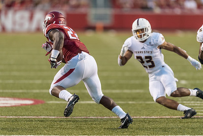 Arkansas Razorbacks running back Rawleigh Williams III (22) rushes during a football game between the Arkansas Razorbacks and the Texas State Bobcats on Saturday, September 17, 2016.  (Alan Jamison, Nate Allen Sports Service)