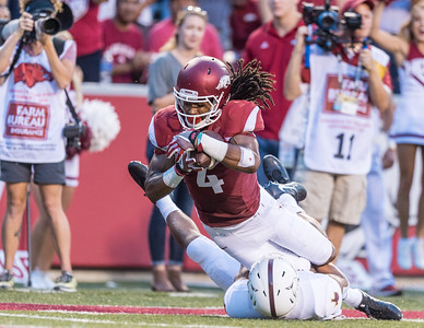Arkansas Razorbacks wide receiver Keon Hatcher (4) is tackled near the end zone by Texas State Bobcats cornerback Clarence Guidry III (23) during a football game between the Arkansas Razorbacks and the Texas State Bobcats on Saturday, September 17, 2016.  (Alan Jamison, Nate Allen Sports Service)