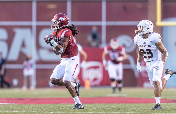 Arkansas Razorbacks wide receiver Keon Hatcher (4) with a catch and run during a football game between the Arkansas Razorbacks and the Texas State Bobcats on Saturday, September 17, 2016.  (Alan Jamison, Nate Allen Sports Service)