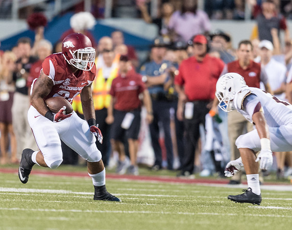 Arkansas Razorbacks running back Kody Walker (24) carries during a football game between the Arkansas Razorbacks and the Texas State Bobcats on Saturday, September 17, 2016.  (Alan Jamison, Nate Allen Sports Service)