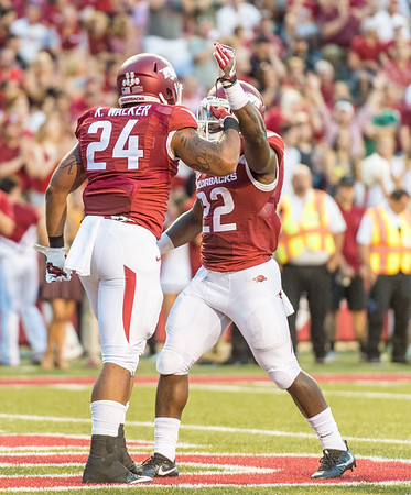 Arkansas Razorbacks running back Rawleigh Williams III (22) congratulates Kody Walker on Walker's touchdown run during a football game between the Arkansas Razorbacks and the Texas State Bobcats on Saturday, September 17, 2016.  (Alan Jamison, Nate Allen Sports Service)