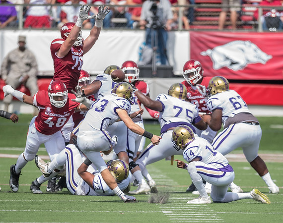 Arkansas Razorbacks offensive lineman Dan Skipper (70) blocks a field goal attempt by Alcorn State Braves kicker Haiden McCraney (33) during a football game between the Arkansas Razorbacks and the Alcorn State Braves on Saturday, October 1, 2016.  (Alan Jamison, Nate Allen Sports Service)