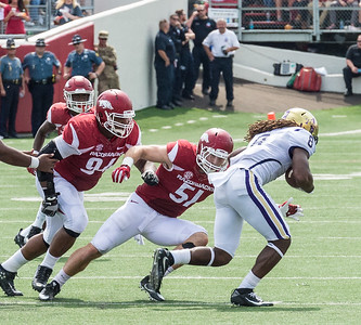 Arkansas Razorbacks linebacker Brooks Ellis (51) tackles Alcorn State Braves running back De'Lance Turner (8) during a football game between the Arkansas Razorbacks and the Alcorn State Braves on Saturday, October 1, 2016.  (Alan Jamison, Nate Allen Sports Service)