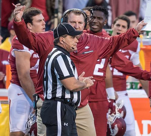 Arkansas Razorbacks head coach Bret Bielema questions side judge Jesse Dupuy during a football game between Arkansas and Alabama on Saturday, October 8, 2016.  (Alan Jamison, Nate Allen Sports Service)