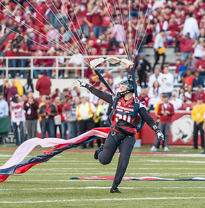 A member of the U.S. Air Force Wings of Blue Parachute Team lands on the field before the football game between Arkansas and Alabama on Saturday, October 8, 2016.  (Alan Jamison, Nate Allen Sports Service)