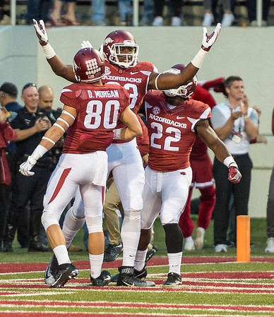 Arkansas Razorbacks tight end Jeremy Sprinkle (83) celebrates a touchdown with Drew Morgan and Rawleigh Williams III during a football game between Arkansas and Alabama on Saturday, October 8, 2016.  (Alan Jamison, Nate Allen Sports Service)