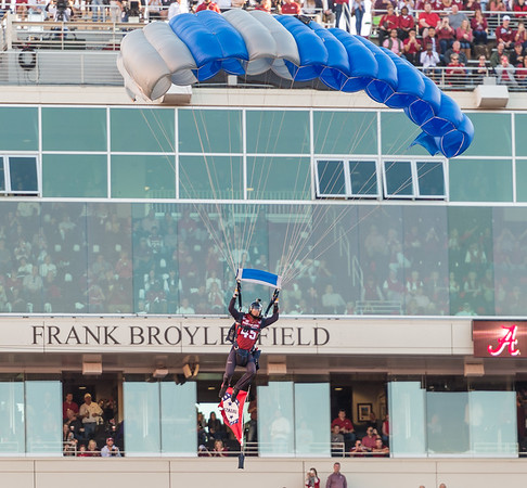 A member of the U.S. Air Force Wings of Blue Parachute Team descends before the football game between Arkansas and Alabama on Saturday, October 8, 2016.  (Alan Jamison, Nate Allen Sports Service)