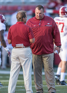 Arkansas Razorbacks head coach Bret Bielema talks to Alabama Crimson Tide head coach Nick Saban before the  football game between Arkansas and Alabama on Saturday, October 8, 2016.  (Alan Jamison, Nate Allen Sports Service)