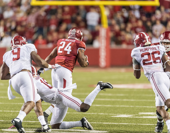 Arkansas Razorbacks running back Kody Walker (24) rushes during a football game between Arkansas and Alabama on Saturday, October 8, 2016.  (Alan Jamison, Nate Allen Sports Service)