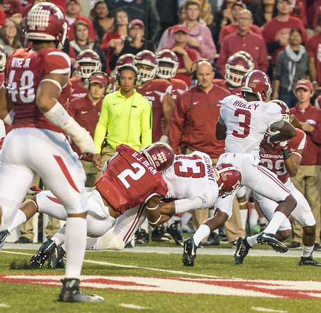 Arkansas Razorbacks defensive back DJ Dean (2) tackles Alabama Crimson Tide wide receiver ArDarius Stewart (13) during a football game between Arkansas and Alabama on Saturday, October 8, 2016.  (Alan Jamison, Nate Allen Sports Service)