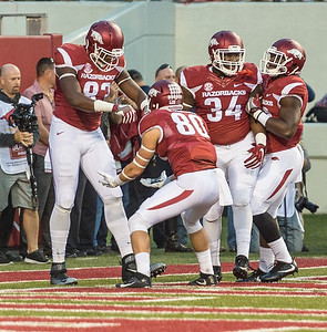 Arkansas Razorbacks tight end Jeremy Sprinkle (83) celebrates a touchdown with Drew Morgan during a football game between Arkansas and Alabama on Saturday, October 8, 2016.  (Alan Jamison, Nate Allen Sports Service)