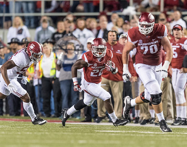 Arkansas Razorbacks offensive lineman Dan Skipper (70) blocks for Rawleigh Williams III during a football game between Arkansas and Alabama on Saturday, October 8, 2016.  (Alan Jamison, Nate Allen Sports Service)