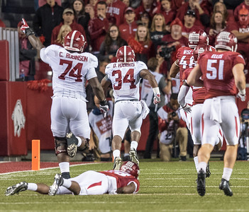 Alabama Crimson Tide running back Damien Harris (34)  rushes for a touchdown during a football game between Arkansas and Alabama on Saturday, October 8, 2016.  (Alan Jamison, Nate Allen Sports Service)