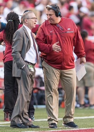 Arkansas Razorbacks head coach Bret Bielema talks to Athletic Director Jeff Long during a football game between Arkansas and Alabama on Saturday, October 8, 2016.  (Alan Jamison, Nate Allen Sports Service)