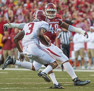 Arkansas Razorbacks defensive lineman Deatrich Wise Jr. (48) tackles Alabama Crimson Tide wide receiver Calvin Ridley (3) during a football game between Arkansas and Alabama on Saturday, October 8, 2016.  (Alan Jamison, Nate Allen Sports Service)