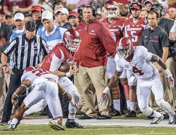 Arkansas Razorbacks quarterback Austin Allen (8) scrambles during a football game between Arkansas and Alabama on Saturday, October 8, 2016.  (Alan Jamison, Nate Allen Sports Service)