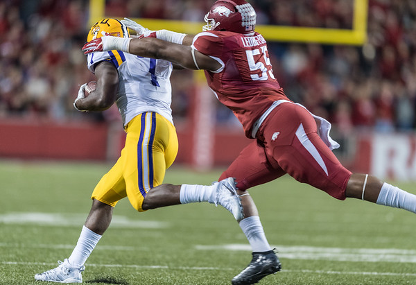 Arkansas Razorbacks defensive lineman Jeremiah Ledbetter (55) tackles LSU Tigers running back Leonard Fournette (7) during a football game between Arkansas and LSU on Saturday, November 12, 2016.  (Alan Jamison, Nate Allen Sports Service)