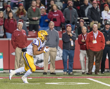 LSU Tigers running back Derrius Guice (5) rushes during a football game between Arkansas and LSU on Saturday, November 12, 2016.  (Alan Jamison, Nate Allen Sports Service)