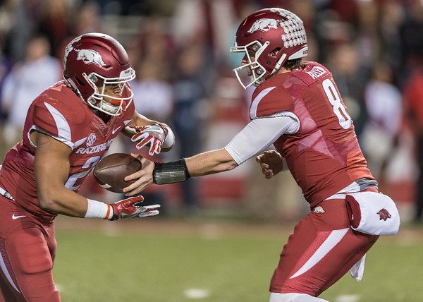Arkansas Razorbacks quarterback Austin Allen (8) hands the ball to Devwah Whaley (21) during a football game between Arkansas and LSU on Saturday, November 12, 2016.  (Alan Jamison, Nate Allen Sports Service)