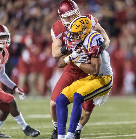Arkansas Razorbacks linebacker Brooks Ellis (51) tackles LSU Tigers wide receiver Malachi Dupre (15)  during a football game between Arkansas and LSU on Saturday, November 12, 2016.  (Alan Jamison, Nate Allen Sports Service)
