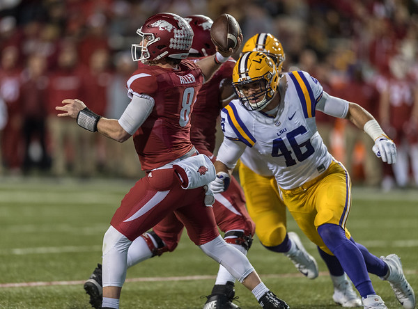 LSU Tigers defensive end Tashawn Bower (46) hurries Arkansas Razorbacks quarterback Austin Allen (8) during a football game between Arkansas and LSU on Saturday, November 12, 2016.  (Alan Jamison, Nate Allen Sports Service)